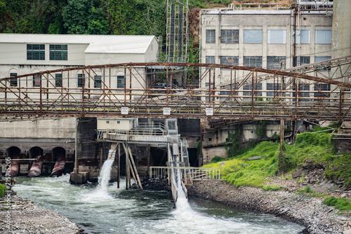 Foto op Canvas Oude verlaten gebouwen Abandoned papermill factory with rusted bridge