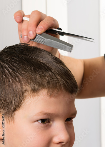 the concept of a stylish haircut of a child, the work of a hairdresser