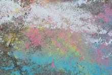 Abstract Chalk Crayons Drawing On Old Grunge Concrete Sidewalk As Colorful Background.