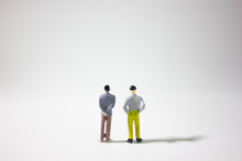 Two Miniature Businessman On G...