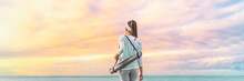 Yoga Woman Walking With Exercise Mat On Morning Sunrise Sky Background In Serenity And Tranquility Panoramic Banner. Active Sport And Fitness Lifestyle.