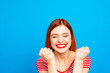 canvas print picture - Portrait of nice vivid girlish red straight-haired happy smiling toothy young girl celebrating lottery victory winning, closed eyes, isolated over blue background