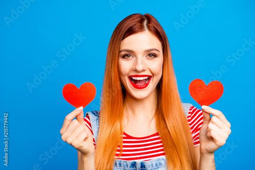 Staande foto Hoogte schaal People person fun joy funny facial expression concept. Close up phoyo portrait of charming glad gorgeous nice cute lovely lady showing holding small little hearts in hands isolated background