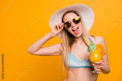 Fotografie, Obraz  Attractive nice cute straight-haired beautiful blonde caucasian girl, wearing blue swimsuit, sun glasses, hat