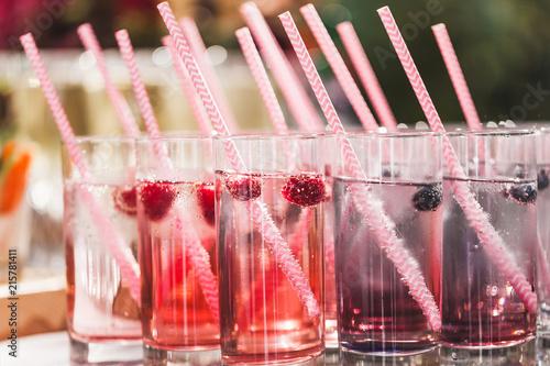 Various cold fresh drinks, berries lemonade closeup on wedding reception