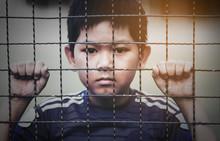 Dark Portrait Of A Boy Stand B...
