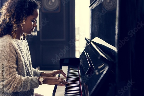 Fototapeta Woman playing on a piano