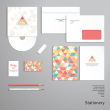 """Vector Templates. Envelope, Cards, Business Cards, Tags, Disc With Packaging, Pencils, Eraser. Multicolored Triangles And Grid. Inscription """"Happy Friday"""". Delicate Backdrop."""
