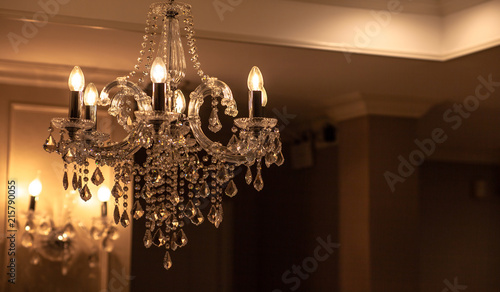 Chrystal chandelier lamp on the ceiling in Dining room Adjusting the image in a Luxury tone .Decorative elegant vintage and Contemporary interior Concept.