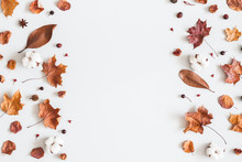 Autumn Composition. Frame Made Of Cotton Flowers, Dried Maple Leaves On Pastel Gray Background. Autumn, Fall Concept. Flat Lay, Top View, Copy Space