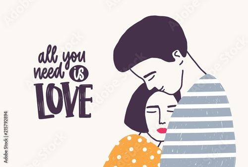 Photo  Embracing young man and woman and All You Need Is Love lettering handwritten with elegant font