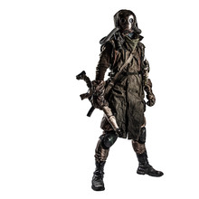 Survivor Inhabitant Of Contaminated By Nuclear Catastrophe Or Dangerous Chemical Pollution World, In Tatters And Gas Mask, Standing With Handmade Firearm Gun, Isolated On White Background Studio Shoot