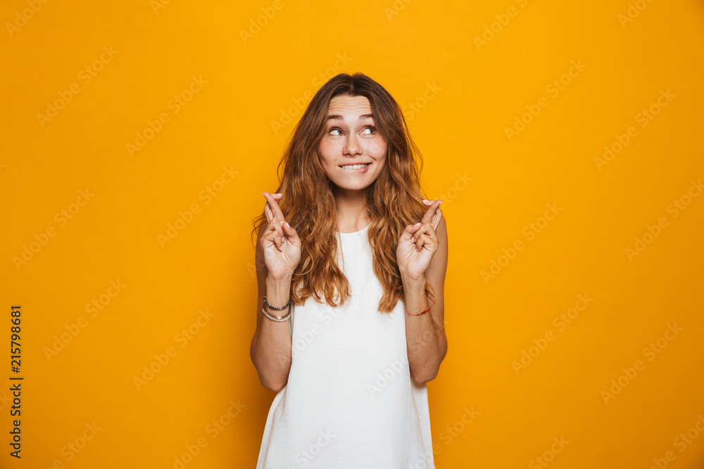 Fototapety, obrazy: Portrait of an excited young girl holding fingers crossed