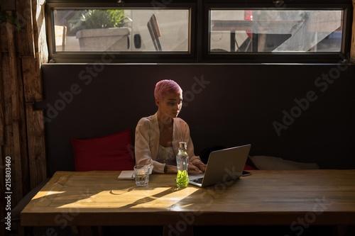 Foto op Plexiglas Restaurant Woman using laptop at restaurant
