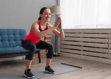 Happy Fitness Woman Doing Squa...