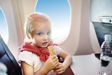 Little Boy Sitting By Aircraft...
