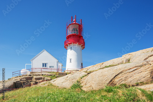 Foto op Aluminium Vuurtoren Looking up at the Lindesnes lighthouse from the access path