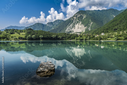Poster Bergen fantastic view with reflections on the lake of tenno close to lago di garda in italy,
