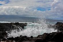 Wave Crashing Over The Lava Rock Coastline Of The Island Of Maui, Hawaii.