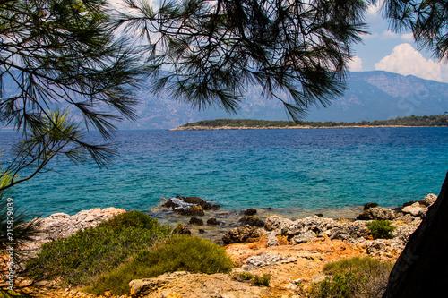 Fotografie, Obraz  beach,rocks and peninsula  in Marmaris Turkey