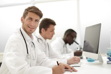 doctor write the results in the laboratory journal.