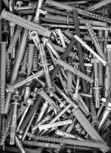 Fotografía  Lot of fasteners and fixings background: anchors, plugs, screws, nails, bolts, n