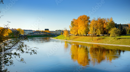 Colorful city park scene in the fall with orange and yellow foliage. Autumn scenery in Vilnius, Lithuania.