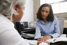 Concerned Female Analyst Counselling Senior Patient