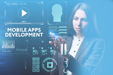 The concept of business, technology, the Internet and the network. A young entrepreneur working on a virtual screen of the future and sees the inscription: Mobile apps development
