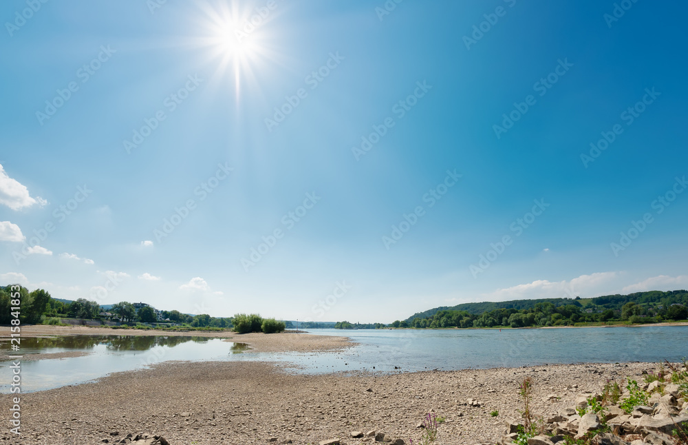 Fototapeta  Low water level in the dried-out riverbed of the river Rhine, North Rhine-Westphalia, Germany