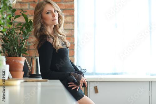 Beautiful woman in black dress Poster