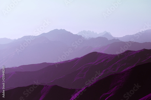 Surrealistic mountain landscape of purple hues