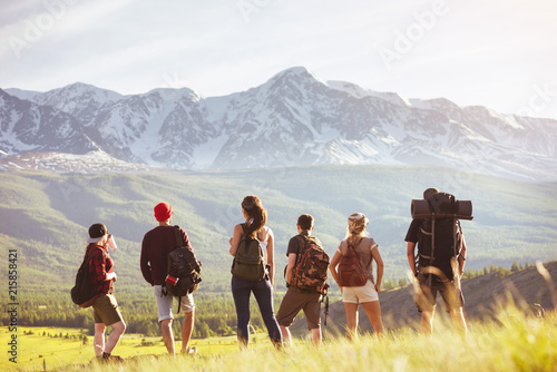 Group of tourists stands against mountain