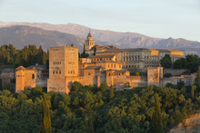 The Alhambra, And Sierra Nevada Mountains In Evening Light From Mirador De San Nicolas, Granada, Andalucia, Spain