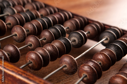 Photo antique abacus on a wooden table close up