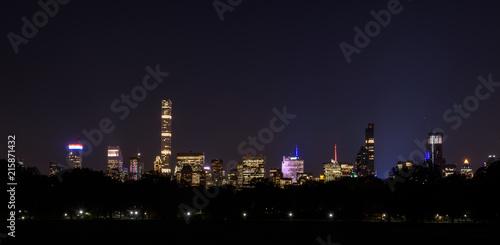 Poster Brooklyn Bridge Skyline of downtown Manhattan by night, New York, United States of America