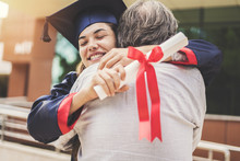 Graduated Student Hugging Her ...