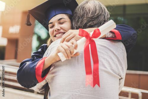 Obraz Graduated student hugging her father - fototapety do salonu