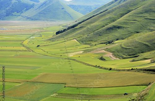 Foto op Plexiglas Pistache Umbria, Italy, Pian Grande of Castelluccio di Norcia with Sibillini mountains