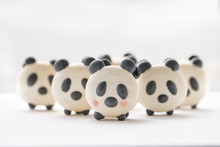 Delicious Almond Desserts In The Form Of Panda. French Macaron Cookies. Cute Sweet Little Animals