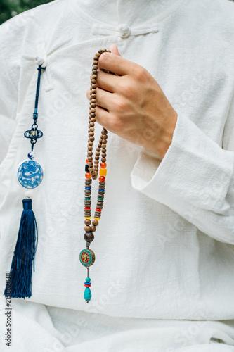 Asian man with zen buddha gesture