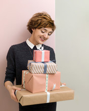 Attractive Woman With Gift Boxes