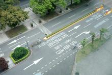 People On Bikes In Traffic In Taipei, Taiwan