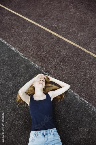 Papiers peints Detente girl relax on the school sport field