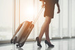 Woman Running with Luggage in Airport