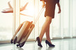 Business Woman Running with Luggage in Airport