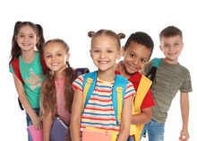 Group Of Little Children With Backpacks And School Supplies On White Background