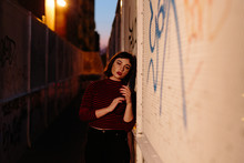 Unhappy Woman Leaning On Graffiti Wall