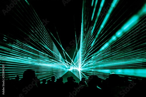 Leinwand Poster Turquois laser show nightlife club stage with party people crowd
