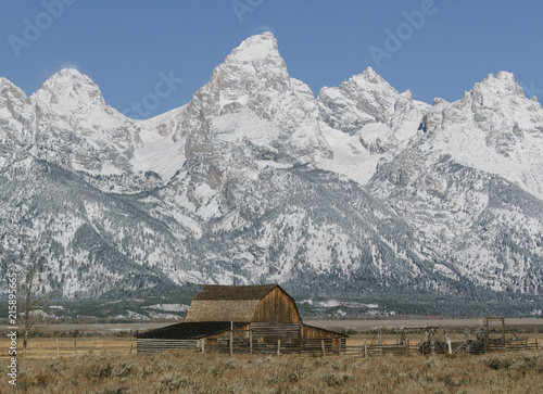 Rustic Barn on Farm At Base of Mountain Range